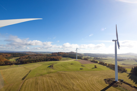 View from above over the countryside with wind turbines